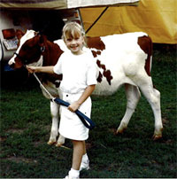 Young girl with cow