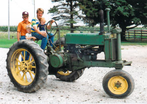 Three generations of farmers on a tractor